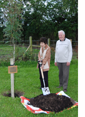 Kei Koide, Japan YM, with Arthur Chapman of Ireland YM planting a Japanese Rowan tree. Photo: Kirk Wright, Western Association.