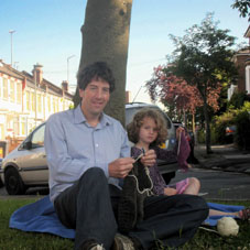 John-Paul Flintoff, with his daughter, crocheting. Photo: Harriet Green.